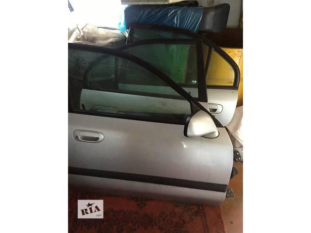 продам Б/у дверь передняя для легкового авто Mitsubishi Carisma бу в Луцке