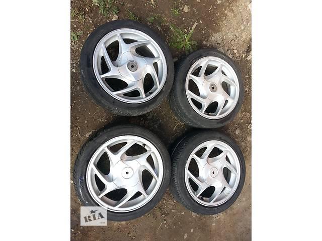 продам Б/у диск с шиной для Ford 4x108 резина 195/45/R15 бу в Коломые