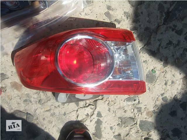 продам Б/у фонарь задний для легкового авто Toyota Corolla бу в Ровно