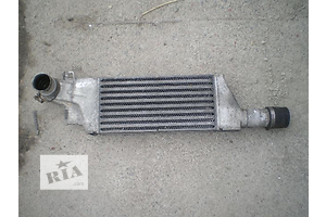 б/у Радиаторы интеркуллера Opel Combo груз.