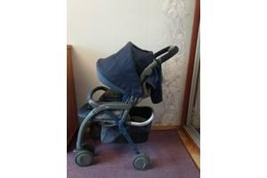 Детская прогулочная коляска  Чико темно синего цвета.
