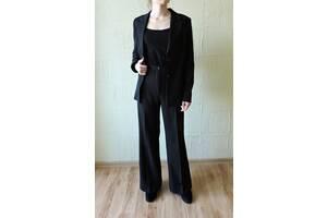 Жіночий брючний костюм, брюки палаццо і піджак