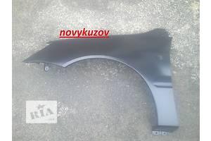 Новые Крылья передние Mitsubishi Lancer