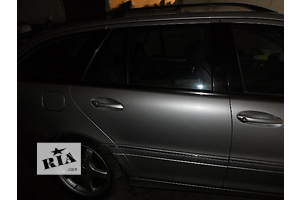 Двери передние Mercedes C-Class