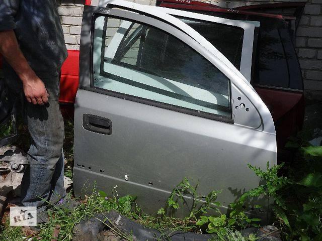 купить бу Двері передні праві для Opel Astra G 2001р. в Львове