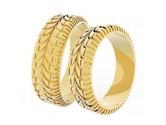продам Эксклюзивные золотые обручальные кольца с протектором protector бу в Києві