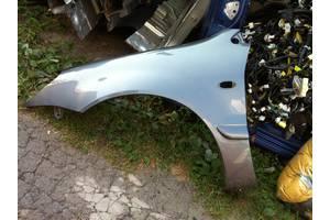 Крылья передние Mitsubishi Lancer