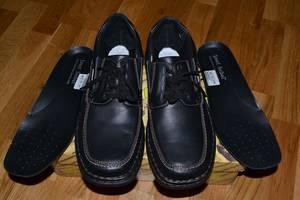 Нові чоловічі черевики і напівчеревики