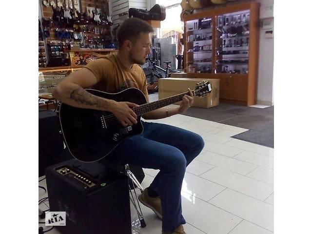 купить бу Уроки гри на гітарі та укулеле очно або онлайн  в Украине