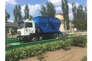 Вывоз строительного и крупногабаритного мусора съемными бункерами объемом 8-10 куб.м.