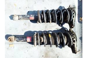 б/в Амортизатори задні / передні Nissan Primera