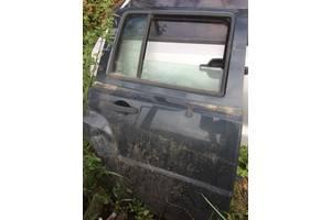 б/в двері задні Jeep Patriot