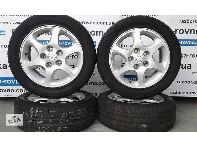 продам Б/у диски колесные Mazda R15 5x114.3 комплект титановых дисков бу в Ровно
