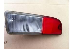 Б / у правый фонарь заднего хода для Suzuki Ignis II