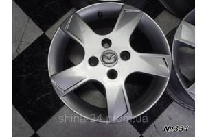 Оригинальные диски Mazda R15 4x108 6Jx15H2 ET52,5 Ford Fiesta,Escort