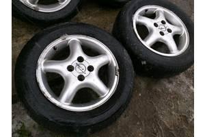 б/в Диски з шинами Opel