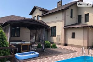 Продается дом на 2 этажа 390 кв. м с бассейном